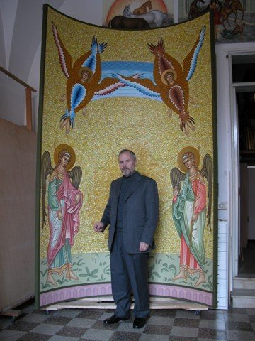 Vasile Mutu in front of his artwork